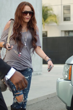 Miley Cyrus Shopping at Maxfield in West Hollywood on January 9, 2010