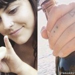 Sierra Kusterbeck smiley face finger tattoo