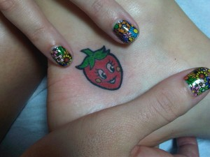 Katy Perry smiling strawberry tattoo
