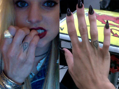 Juliet Simms heart and cross tattoo on her finger