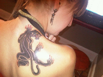 Juliet Simms panther tattoo