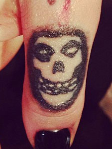Ash Costello Misfits skull tattoo