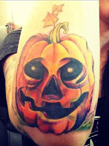 Ash Costello pumpkin elbow tattoo