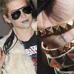 kesha cross wrist tattoo