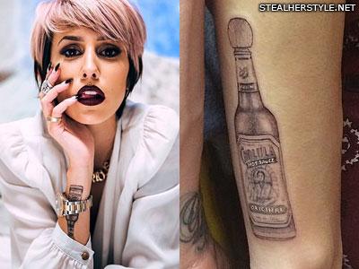 Dev hot sauce arm tattoo