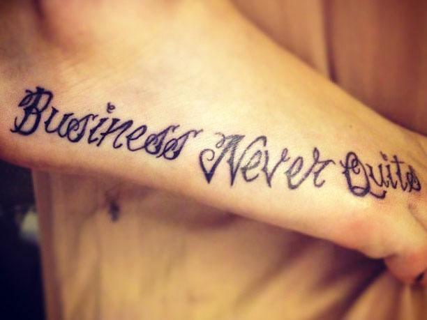 allison tattooed the words business never quits on her right