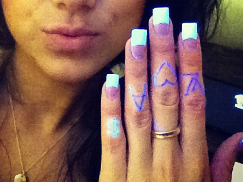 Melissa Marie Green UV knuckle tattoos
