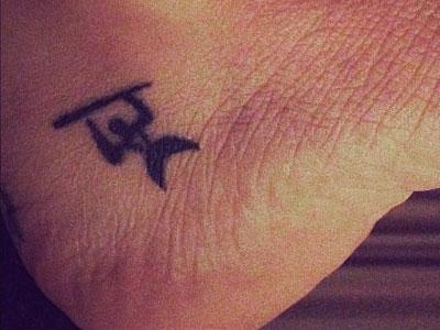 Christina Perri man foot tattoo