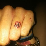 Krysta Cameron finger heart tattoo