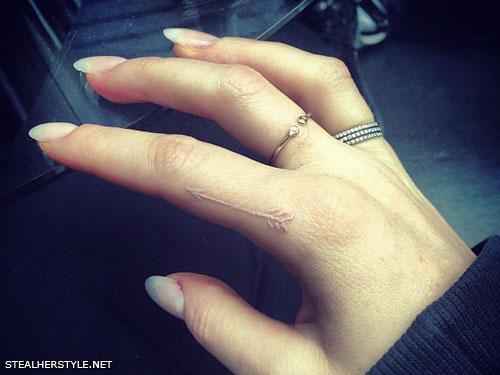 Ellie Goulding white ink arrow tattoo