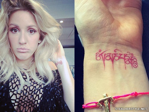 Ellie Goulding red ink wrist tattoo