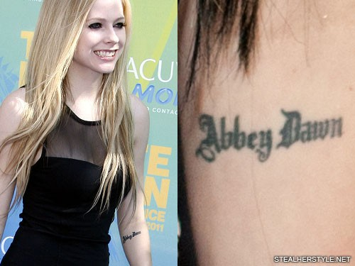 0dcb767ad Avril Lavigne's Tattoos & Meanings | Steal Her Style