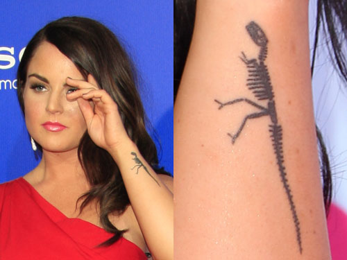 Jojo Levesque dinosaur arm tattoo