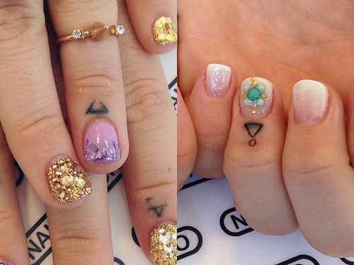 JoJo learn triangle finger tattoo