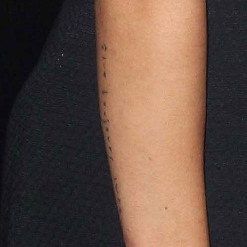 Zo kravitz tattoos steal her style for Tattoo forearm writing