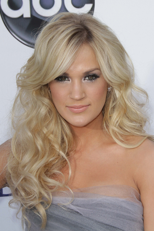carrie underwood curly ash blonde sideswept bangs