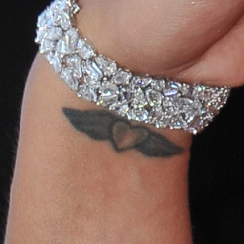 86ed4a002 Cassie's Heart & Wings Wrist Tattoo | Steal Her Style
