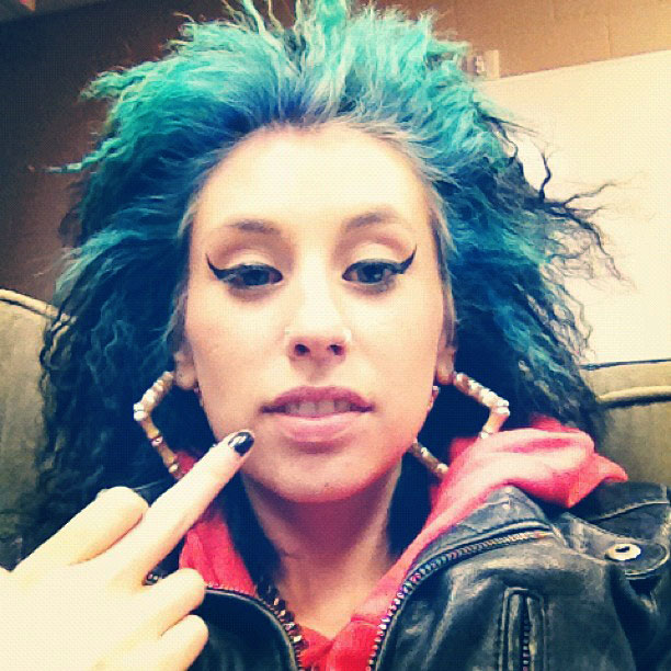 Kreayshawn Crimped, Teased Black Colored Bangs Hairstyle ...