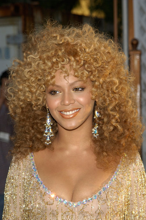 beyonc233 curly honey blonde afro twotone hairstyle