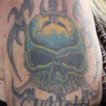 lita-ford-black-skull-dagger-arm-tattoo