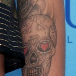 cher-lloyd-skull-rose-tattoo