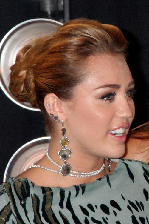 Miley Cyrus Wavy Ginger Bun, Updo Hairstyle | Steal Her Style