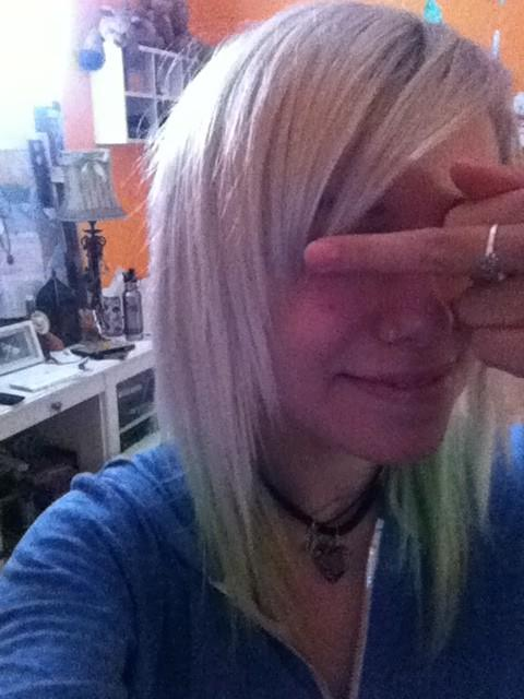 Jenna McDougall had green highlights in her platinum blonde hair ...