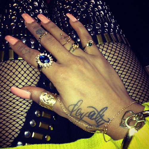 Cardi B Hand Tattoos: 9 Loyalty Tattoo Photos & Meanings