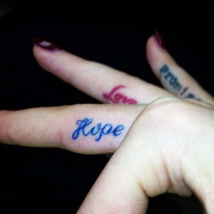 Rita ora tattoos steal her style for Pinky finger tattoos