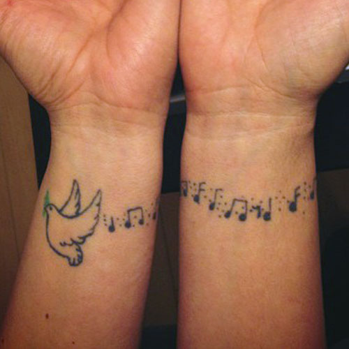 Colleen D'Agostino's Dove & Music Notes Wrist Tattoo ...