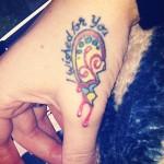 ash-costello-heart-hand-tattoo