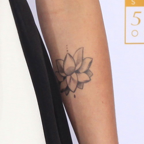 Ireland baldwin tattoos steal her style for Forearm flower tattoos