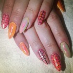 bonnie-mckee-nails-orange-grid
