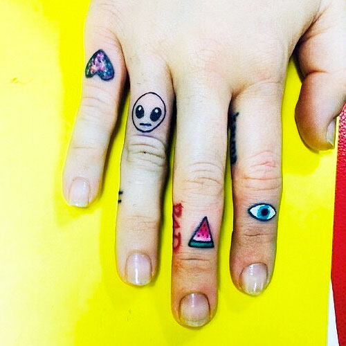 Miley cyrus 16 tattoos meanings steal her style for Eye finger tattoo