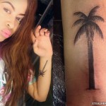 Amira McCarthy palm tree arm tattoo