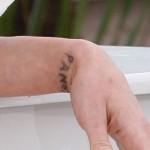 asia-argento-wrist-tattoo