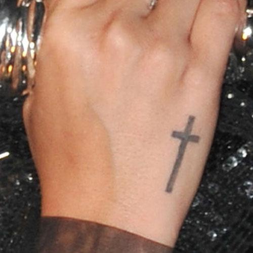 Demi Lovato Cross Side Of Hand Tattoo