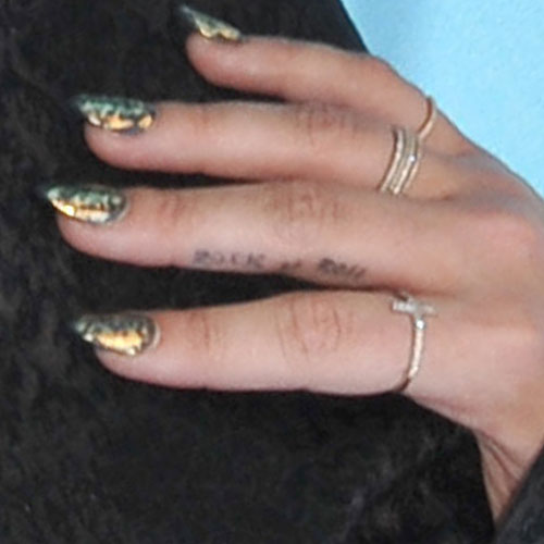 demi-lovato-rock-n-roll-finger-tattoo-