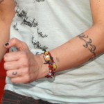 janeane-garofalo-initial-tattoo