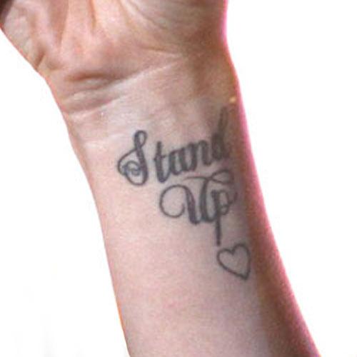 jessie-j-stand-up-wrist-tattoo
