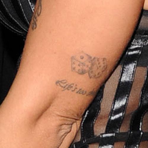 Jodie Marsh Dice Writing Upper Arm Tattoo