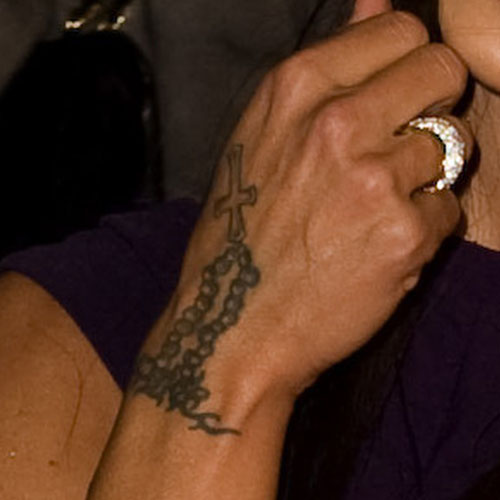 Jodie marsh cross jewelry rosary back of hand tattoo steal her