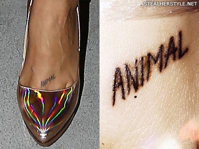 Kesha animal foot tattoo