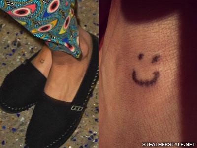 Kesha smiley face foot tattoo