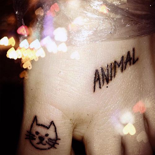 kesha-tattoo-foot-animal-cat