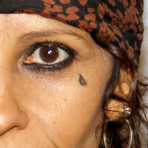 Linda perry 39 s 8 tattoos meanings steal her style for Tear tattoo meaning on face