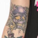 megan-massacre-skull-arm-tattoo