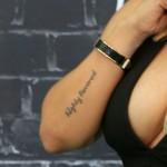 tameka-tiny-harris-highly-favored-arm-tattoo