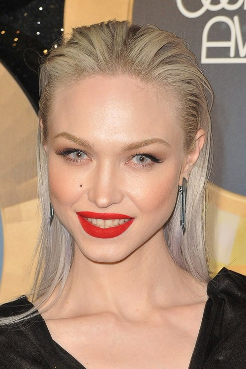 Ivy Levan Straight Ash Blonde Slicked Back Hairstyle