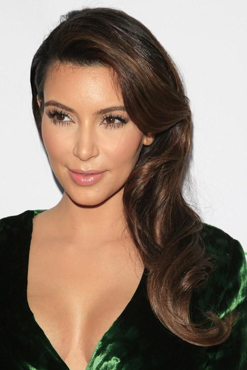Kim Kardashian Wavy Dark Brown Faux Sidecut Side Part Hairstyle